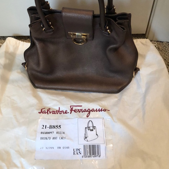 Authentic Salvatore Ferragamo bronze purse. M 5add10e93afbbd1c9ab56f0b bea8537dd4c56